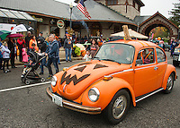 Pumpkins of all shapes and sizes and even some with wheels during the parade through Laconia during Pumpkin Fest on Saturday.  (Karen Bobotas/for the Laconia Daily Sun)