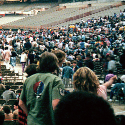 Detail of crowd far right. A slice of the full Interior of the Venue before the start of the Grateful Dead in Concert at the Carrier Dome, Syracuse University, New York on the 20th of October 1984. Photographed Dead Center Rear view Forward.