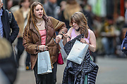 People carry shopping bags in Soho, central London, Monday, April 12, 2021. Millions of people in England will get their first chance in months for haircuts, casual shopping and restaurant meals on Monday, as the government takes the next step on its lockdown-lifting road map. (Photo/ Vudi Xhymshiti)