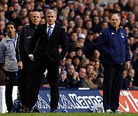 Photo: Daniel Hambury.<br />Tottenham Hotspur v Blackburn Rovers. The Barclays Premiership. 05/03/2006.<br />Tottenham's manager Martin Jol (R) and Blackburn's manager Mark Hughes look on.