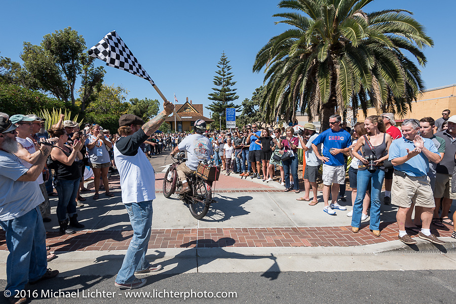The journey is over. 3,400 miles from the Atlantic to the Pacific. Alex Trepanier of California riding his single-cylinder single-speed 1913 Indian class-1 bike crosses the finish line of the Motorcycle Cannonball Race of the Century. Stage-15 ride from Palm Desert, CA to Carlsbad, CA. USA. Sunday September 25, 2016. Photography ©2016 Michael Lichter.