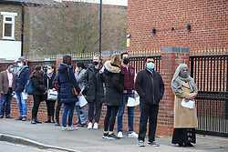 © Licensed to London News Pictures. 21/03/2021. London, UK. Members of the public queue outside Masjid Ayesha, a mosque in Tottenham, north London. The mosque is working in partnership with Federated4Health and is encouraging local communities to be inoculated. The government announced that over 26 million people have now received a first dose of a vaccine and over 2 million have received their second dose of a vaccine. Prime Minister Boris Johnson received his first dose on Friday. Photo credit: Dinendra Haria/LNP