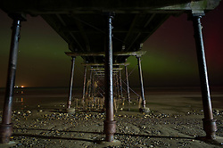 © Licensed to London News Pictures. 27/02/2014<br /> <br /> Saltburn, England<br /> <br /> The Aurora Borealis is visible through the Victorian Pier in Saltburn by the Sea in Cleveland.<br /> <br /> Photo credit : Ian Forsyth/LNP