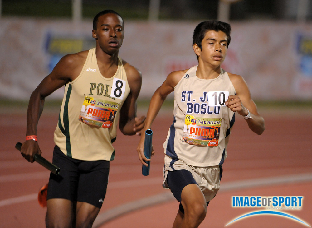 Apr 15, 2011; Walnut, CA, USA; Danny Martinez of St. John Bosco (right) and Myles Andres of Long Beach Poly run the anchor leg in the 4 x mile relay in the 53rd Mt. San Antonio College Relays at Hilmer Lodge Stadium.