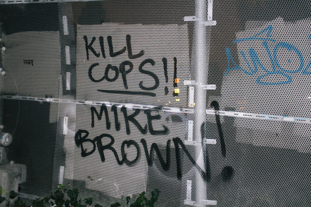 """Graffiti that says """"Kill Cops!"""" and """"Mike Brown!"""""""