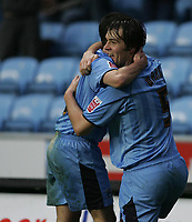 Photo: Lee Earle.<br /> Coventry City v Southend United. Coca Cola Championship. 30/12/2006. Coventry's Elliott Ward (R) is congratulated after scoring their opening goal.