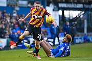 Bradford City defender Anthony McMahon (29) evades the challenge of Oldham Athletic defender Jamie Reckford (3)  during the EFL Sky Bet League 1 match between Oldham Athletic and Bradford City at Boundary Park, Oldham, England on 28 January 2017. Photo by Simon Davies.