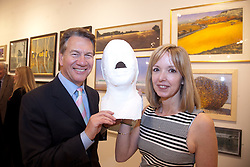 © London News Pictures. 28/02/2012.Rt. Hon. Michael Portillo MP and Louise Giblin with the head cast of Michael Portillo to be used in a future piece in 2014 called Living Legends. Rt. Hon. Michael Portillo MP opens the the private view of the 295th Exhibition of The Royal Society of British Artists at the Mall Galleries, London, UK. Picture credit should read Manu Palomeque/LNP