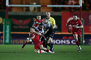 Gareth Davies of Scarlets makes a break in the 2nd half but is stopped by a high tackle around his neck from Toulon's  Semi Radradra Turagasoli Waqavatu  .   EPCR European Champions cup match, Scarlets v RC Toulon at the Parc y Scarlets in Llanelli, West Wales on Saturday 20th January 2018. <br /> pic by  Andrew Orchard, Andrew Orchard sports photography.