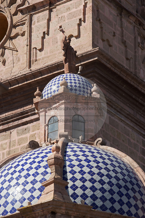 Detail of the conflicting architectural styles on Morelia Cathedral on the Plaza de Armas Morelia, Michoacan state Mexico. The city is a UNESCO World Heritage Site and hosts on of the best preserved collection of Spanish Colonial architecture in the world. Commissioned by the Duke of Albuquerque, appointed Viceroy to the territories of Mexico, ordered its construction in 1660 which was carried out by the Italian master Vicente Barroso until his death in 1692 it took an additional 52 years to complete. The Cathedral has the highest and bulkiest church towers of the continent.