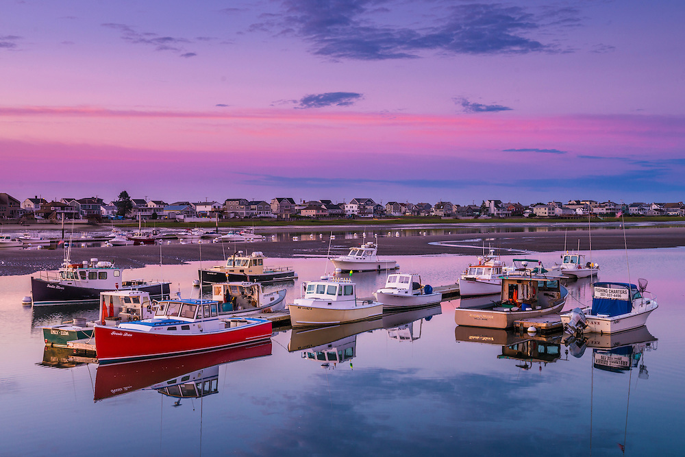 Dawn colors in sky, cottages on Atlantic Ave, with lobster fishing boats docked, Webhannet River, Wells, ME