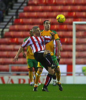 Photo: Andrew Unwin.<br />Sunderland v Norwich City. Coca Cola Championship. 02/12/2006.<br />Sunderland's Graham Kavanagh (L) looks to flick the ball over Norwich's Andy Hughes (R).