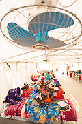 Women sit inside a tent with their malnourished children at a UNICEF-sponsored therapeutic feeding center at the Mongo hospital in the town of Mongo, Guera province, Chad on Tuesday October 16, 2012.
