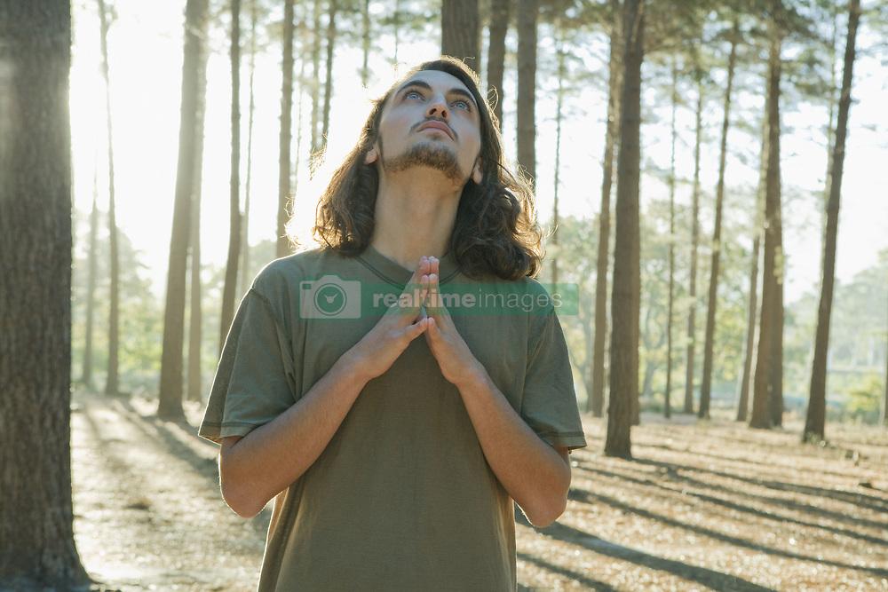 Apr. 28, 2010 - Man standing in forest. Model Released (MR) (Credit Image: © Cultura/ZUMAPRESS.com)