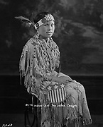 "9305-B7343.  Katherine Smith Courtney (1912-2002), who lived at the Warm Springs Reservation in Oregon. Her daughters include the ""Sally Sisters,"" basket makers Pat Courtney Gold and Bernyce Courtney. photographed in Markham's Studio in The Dalles, 1928"