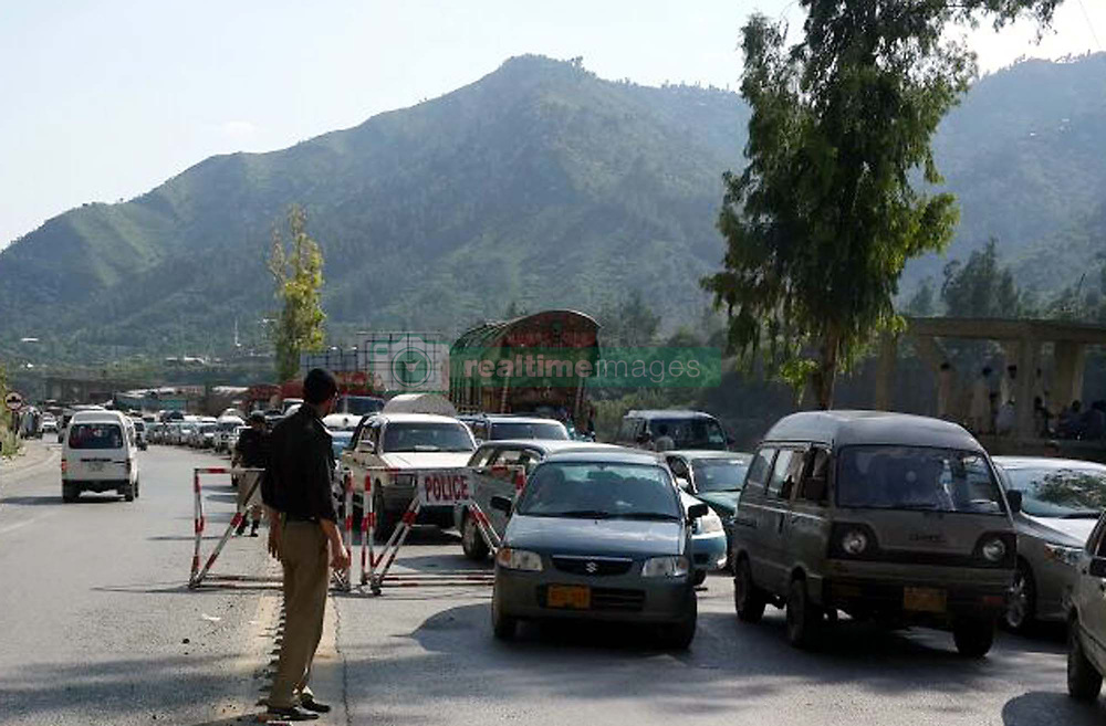 July 3, 2017 - Pakistan - ABBOTTABAD, PAKISTAN, JUL 03: Traffic police temporary blocked the road to avoid .traffic blockage due to heavy traffic of the tourists in Abbottabad on Monday, July 03, 2017. (Credit Image: © PPI via ZUMA Wire)