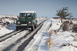 ***CAPTION CORRECTION***© Licensed to London News Pictures. 14/01/2015. Wheddon Cross, Somerset, UK. Two women out in their 4x4 coming back from a walk to take photographs on Dunkery Hill in Exmoor National Park, Somerset this morning, 14th January 2015. Snow has fallen overnight across many parts of England, causing travel disruption in some areas.  Photo credit : Rob Arnold/LNP