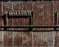 Gallery Sign on a Rusted Wall in Jerome, Arizona. Image taken with a Nikon 1 V2 camera and 32 mm f/1.2 lens (ISO 160, 32 mm, f/4, 1/1000 sec). Nikonians ANPAT 13.