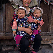 China, People, Tibetan farmers, Mother with twin Children. Sichuan, China.