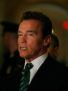 California Governor Arnold Schwarzenegger talks to press in the United States Capitol after meeting with congressmen. Photograph by Dennis Brack