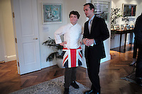 NEW YORK - April 10, 2014 - 13 year old Alexander Weiss, left, was the winner of Master Chef Junior on TV. He goes to the British International School in New York and was invited by the British Consul General, Danny Lopez, right, to prepare a British themed dinner at the consul's residence. <br /> (Photo by Robert Caplin)