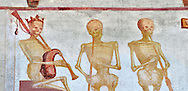 """The Church of San Vigilio in Pinzolo and its fresco paintings """"Dance of Death"""" painted by Simone Baschenis of Averaria in1539, Pinzolo, Trentino, Italy.<br /> <br /> The mural continues for another 21 meters with a long procession with 40 figures. The Mural opens on its left with a skeleton on the throne, bearing a sceptre and the crown and playing a bagpipe. These skeletons are playing the music which is the backdrop to """"Dance of Death"""" ( Danza macabra ) and suggests that they are playing with our fate on earth. .<br /> <br /> Visit our MEDIEVAL ART PHOTO COLLECTIONS for more   photos  to download or buy as prints https://funkystock.photoshelter.com/gallery-collection/Medieval-Middle-Ages-Art-Artefacts-Antiquities-Pictures-Images-of/C0000YpKXiAHnG2k<br /> If you prefer to buy from our ALAMY PHOTO LIBRARY  Collection visit : https://www.alamy.com/portfolio/paul-williams-funkystock/san-vigilio-pinzolo-dance-of-death.html"""