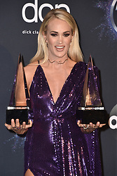Carrie Underwood poses in the press room with the Favorite Album - Country and the Favorite Female Artist - Country awards during the 2019 American Music Awards at Microsoft Theater on November 24, 2019 in Los Angeles, CA, USA. Photo by Lionel Hahn/ABACAPRESS.COM