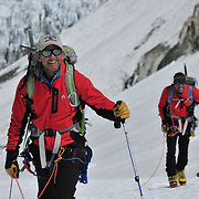Peter Whittaker and Ed Viesturs navigate the crevasses of the Khumbu Glacier on Mount Everest en route to the base of the Lhotse Face.