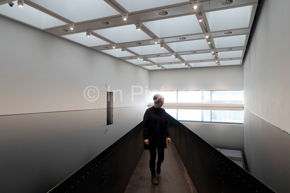 Visitors interacting with artworks at the Space Shifters exhibition at the Hayward Gallery on 16th December 2018 in London, United Kingdom. The exhibit was a major group show of sculptures and installations that explored perception and space, featuring 20 artists. 20:50 1987 by Richard Wilson