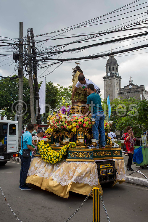 People setting up their floats in preparation for the Grand Marian Parade in Intramuros, Manila, Metro Manila, Philippines. The Intramuros Grand Marian Procession is an annual procession on the first Sunday of December that honours the Feast of the Immaculate Conception.