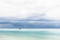Storm clouds building up over tranquil tropical waters , Vamizi Island, Mozambique