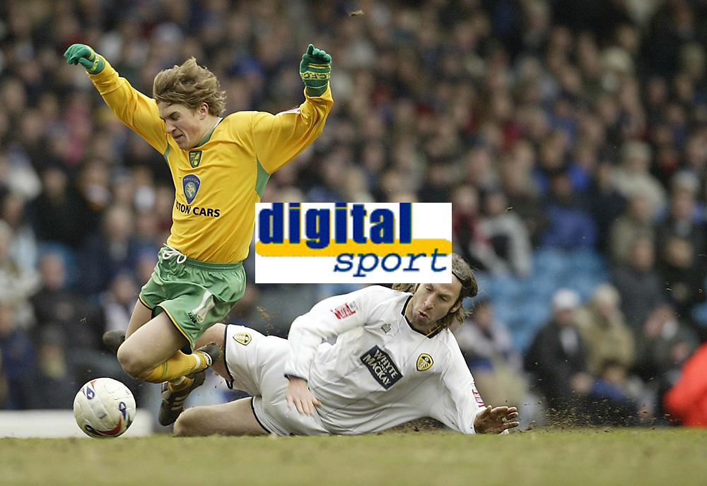 Photo: Aidan Ellis.<br /> Leeds United v Norwich City. Coca Cola Championship. 11/03/2006.<br /> Leeds Shaun derry brings down Norwich's Paul McVeigh
