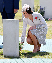 The Duchess of Cambridge lays flowers at a grave at Tyne Cot Commonwealth War Graves Cemetery in Ypres, Belgium, at a commemoration ceremony to mark the centenary of Passchendaele.