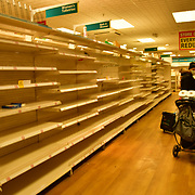 During the coronavirus in UK lockdown seen people shopping in Poundland shelf empty, at Walthamstow Shopping mall,on 28 March 2020 London.