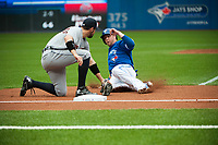 August 29 2015: Detroit Tigers Second base Ian Kinsler (3) [4986] tags out Toronto Blue Jays First base Justin Smoak (13) [7658] at third base in the first inning at Rogers Centre in Toronto, ON, Canada.