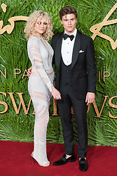 © Licensed to London News Pictures. 04/12/2017. London, UK. PIXIE LOTT and OLIVER CHESHIRE arrives for The Fashion Awards 2017 held at the Royal Albert Hall. Photo credit: Ray Tang/LNP