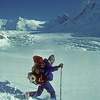 Ski mountaineer Allan Pietrasanta telemarks in powder snow below 16,000 foot Warwan Pass during a pioneering two-week ski expedition across India's Great Himalaya Range, from Ladakh to Kashmir.