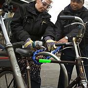 Nederland Rotterdam 5 maart 2009 20090305 Foto: David Rozing ..In het kader van Schoon, heel en veilig heeft Stadstoezicht op donderdag 5 maart samen met Roteb 851 fietswrakken verwijderd. Medewerkers stadstoezicht slijpen kettingslot door om fietswrakken te verwijderen.  Old bicycle wrecks.are being removed by workers of the city of Rotterdam, cycle, broke, broken, wreck, cleaning up city.Waarom? Daarom!?Gemeente ruimt 851 fietswrakken op.In het kader van Schoon, heel en veilig heeft Stadstoezicht op donderdag 5 maart samen met Roteb 851 fietswrakken verwijderd. Tijdens de stadsbrede actiedag op 5 maart heeft Stadstoezicht ook enkele tientallen onbeheerde en hinderlijk geparkeerde fietsen afgevoerd. Verder heeft de gemeente honderden kettingsloten van hekken en lichtmasten verwijderd.??Grote opruiming?In de afgelopen twee weken heeft Stadstoezicht 1100 fietswrakken aangetroffen. Door een sticker op de fiets werd de eigenaar gewaarschuwd voor het verwijderen van het wrak door de gemeente. Op de actiedag gingen verschillende teams van Stadstoezicht gewapend met een slijptol op pad. Zij werden vergezeld door medewerkers van Roteb, zij hebben de wrakken gelijk afgevoerd. Bovendien werden ook nog honderden kettingsloten van hekken en lichtmasten verwijderd.??Onbeheerde en hinderlijk geparkeerde fietsen?De gemeente heeft niet alleen fietswrakken en verkeerd geparkeerde fietsen weggehaald. Stadstoezicht controleert ook op onbeheerde en hinderlijk geparkeerde fietsen. Daarvan zijn er nog eens enkele tientallen van straat gehaald.??Fiets weg??Is iemand zijn fiets kwijt, dan kan het dus zijn dat Stadstoezicht hem heeft laten weghalen. Fietswrakken worden 14 dagen bewaard en andere fietsen 13 weken. Eigenaren kunnen hun fiets terugkrijgen tegen betaling van de verwijderkosten Rotterdammers kunnen helpen door te melden waar overlastgevende fietsen staan. ..Foto: David Rozing