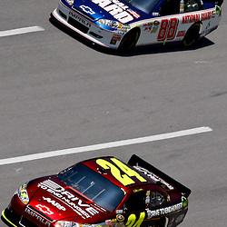 April 17, 2011; Talladega, AL, USA; NASCAR Sprint Cup Series driver Jeff Gordon (24) leads Dale Earnhardt Jr. (88) during the Aarons 499 at Talladega Superspeedway.   Mandatory Credit: Derick E. Hingle