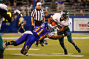 Sacramento State Hornets running back EZEKIEL GRAHAM (8) breaks through a tackle by San Jose State Spartans linebacker KEITH SMITH (31) during the season opener at San Jose State University's Spartan Stadium in San Jose, California, on August 29, 2013. The San Jose State Spartans beat the Sacramento State Hornets 24-0. (Stan Olszewski/ZUMA Press)