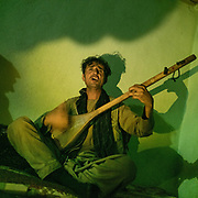 Abdul Qadir, playing the traditional dombra musical instrument. The traditional life of the Wakhi people, in the Wakhan corridor, amongst the Pamir mountains.