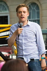 London, June 17th 2017. Several thousand protesters demonstrate against the Conservative's intended alliance with the Democratic Unionist Party (DUP) in Whitehall, London. The proposed pact will enable the Tories to maintain a small level of dominance in the House of commons after their majority was wiped out in the June 8th general election. PICTURED: Rally organiser and political activist and writer Owen Jones.