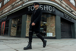 © Licensed to London News Pictures. 28/01/2021. LONDON, UK. A man passes a branch of Topshop on Oxford Street, the traditional home of retail in the West End. Online retailer Asos is reported to be interested in buying the parts of the business from owner Arcadia which recently collapsed into administration.  Already suffering from competition from online shopping, the coronavirus pandemic has resulted in reduced footfall and lockdowns have forced non-essential shops to close.  Photo credit: Stephen Chung/LNP