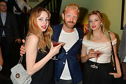 Left to right, GRETA BELLAMACINA, ALISTAIR GUY and COSIMA BELLAMACINA at a Bastille Day Cocktail Party at L'Escargot, 48 Greek Street, London on 14th July 2014.