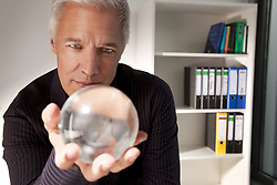 Mar. 19, 2010 - Businessman holding a crystal ball. Model and Property Released (MR&PR) (Credit Image: © Cultura/ZUMAPRESS.com)