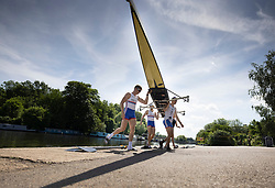 © Licensed to London News Pictures. 08/06/2021. London, UK. Rowers bring their boat ashore on a sun drenched River Thames at Molesey in south west London.The warm sunny weather continues with high temperatures and sunshine. Photo credit: Peter Macdiarmid/LNP