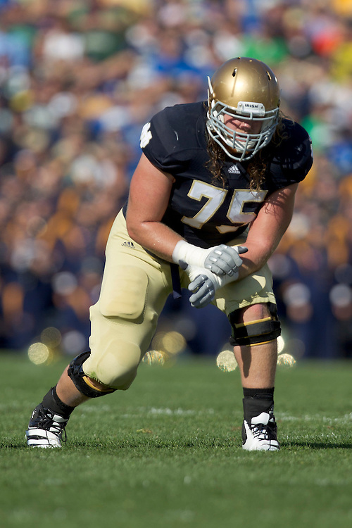 Notre Dame offensive tackle Taylor Dever (#75) in action during NCAA football game between Notre Dame and Air Force.  The Notre Dame Fighting Irish defeated the Air Force Falcons 59-33 in game at Notre Dame Stadium in South Bend, Indiana.