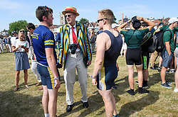 © Licensed to London News Pictures. 04/07/2018. Henley-on-Thames, UK. Rowers from Leeds Rowing Club chat after a race at day one of the Henley Royal Regatta, set on the River Thames by the town of Henley-on-Thames in England. Established in 1839, the five day international rowing event, raced over a course of 2,112 meters (1 mile 550 yards), is considered an important part of the English social season. Photo credit: Ben Cawthra/LNP