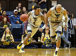 Jan 15, 2018; Morgantown, WV, USA; West Virginia Mountaineers guard Daxter Miles Jr. (4) dribbles the ball up the floor during the second half against the Kansas Jayhawks at WVU Coliseum. Mandatory Credit: Ben Queen-USA TODAY Sports
