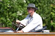 © Intersport  Images <br /> <br /> Photo Peter Spurrier.<br /> Card No. 4/52<br /> <br /> Matt Pinsent Sydney Gold medallist, tries another craft to travel the rowing course, driving a launch at Women's Henlay regatta. 20010623 Women's Henley Regatta.